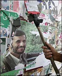 Election posters, including one of hardline Tehran mayor Mahmoud Ahmadinejad, are removed in downtown Tehran