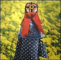 Babak doll photographed in a field