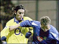 Robert Pires and Matthew Taylor tussle for possession