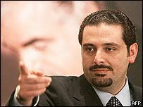 Saad Hariri, the son of slain ex-premier Rafik Hariri (background picture)