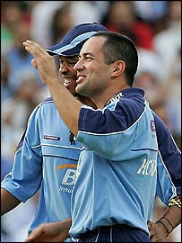 Adam Hollioake celebrates a wicket