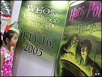 A young fan studies the cover of Harry Potter and the Half-Blood Prince