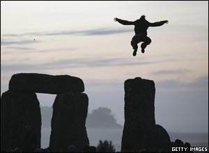 Man jumping from the stones to celebrate the midsummer sun