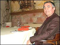 Mr Bobryshev sitting in his Italian restaurant
