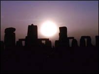 Sun rising over Stonehenge