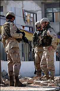 US soldiers inspect the site of a mortar attack in Iraq