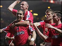 Charlton celebrate Talal El Karkouri's headed goal