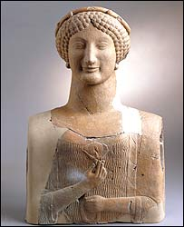 Bust of a woman carrying a lotus flower, about 500BC