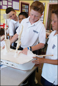 Pupils hold their model of HMS Victory