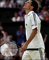 Tim Henman is clearly relieved after beating Jarko Nieminen