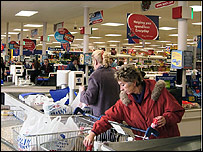 Tesco shoppers at check-out