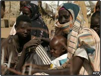Sudanese women and children in a small town in Darfur