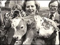 Margaret Thatcher cuddles a calf in the 1979 election campaign