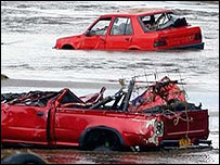 Cars washed away in the flooding