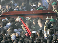 Yasser Arafat's coffin amongst the crowds