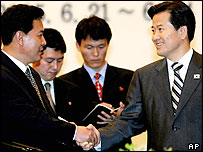 Kwon Ho-ung, (L), the head of the North Korean delegation, shakes hands with South Korean Unification Minister Chung Dong-young, June 22, 2005.
