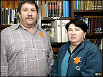Moshe Freiman and his wife Itah wearing orange stars