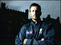 Mike Kasprowicz stands outside Lumley Castle