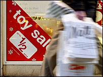 Shopper by sale sign