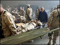 The aftermath of the attack at the US base near Mosul, 21 December 2004