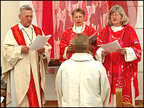 Woman being ordained