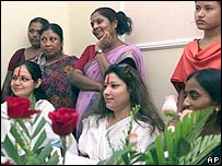 Indian sex worker surround their Pakistani counterpart Rani, seated centre