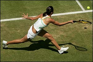 Russia's Anastasia Myskina stretches for the ball