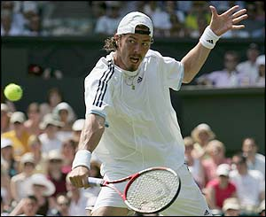 Marat Safin volleys at the net