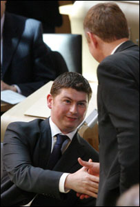 Derek Brownlee being congratulated in the Holyrood chamber