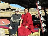Lin Gu (l) and Nyima Tsering (r) sitting on the golden roof of Jokhang Temple (Photo by Lin Gu)