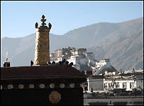 Potala Palace in the distance viewed from the roof of Jokhang Temple (Photo by Lin Gu)