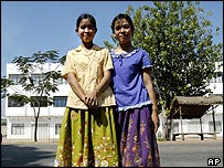 Textile workers Sophy and Sophoeun Paon in front of a garment factory where they used to work