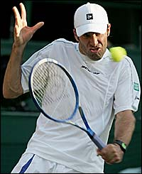 Greg Rusedski puts all his effort into a backhand volley