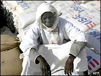 Man guards humanitarian aid at Kalma camp in Darfur, Sudan