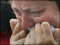 A mother who lost her nine-year-old daughter cries as she visits the school