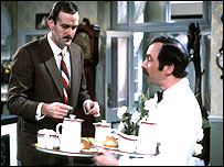 John Cleese as Basil Fawlty and Andrew Sachs as Manuel in Fawlty Towers
