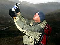 Lake District park ranger Pete Collins with the bottled air