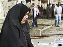 An Iraqi woman weeps at the scene of a car bomb attack near a Shia mosque in Baghdad