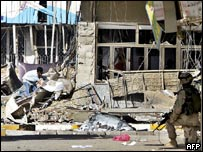 A boy searches through the wreckage of a shop destroyed by a bomb in central Baghdad