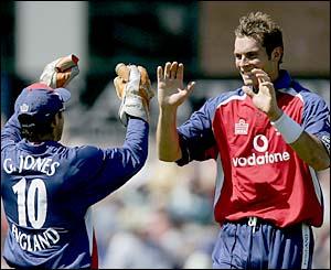 England's Geraint Jones and Chris Tremlett celebrate the wicket of Matthew Hayden