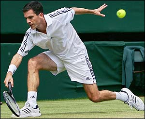 Henman lunges for the ball