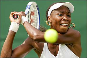 Venus Williams powers the ball to Australia's Nicole Pratt