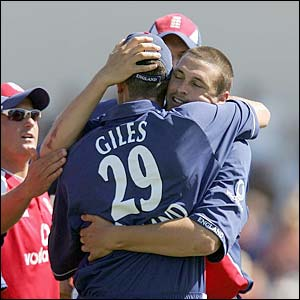 Ashley Giles is congratulated by Steve Harmison for catching Ricky Ponting