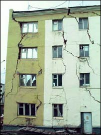 Permafrost thaw damaged building (ACIA)