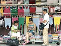 Buyers and seller make a deal at a textile wholesale market in Shanghai