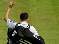 Tim Henman waves goodbye to Centre Court after his defeat
