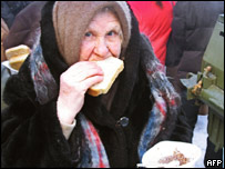 An old Russian woman eats a charity lunch in Saratov (file picture)