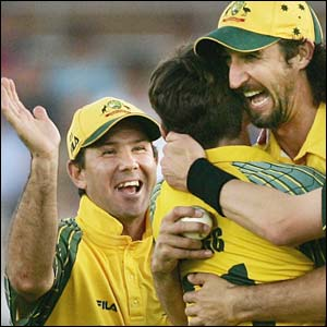 Ricky Ponting, Brad Hogg and Jason Gillespie celebrate the wicket of Andrew Flintoff