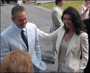 Catherine Zeta Jones and Michael Douglas chatting to one of the guests at the opening