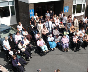 Before their visit ended Zeta Jones and Douglas were pictured with most of the centre's users